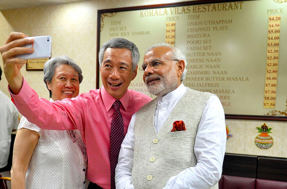 The Prime Minister of Singapore, Mr. Lee Hsien Loongundefinedand the Prime Minister of India, Mr Narendra Modi taking a selfie at Komala Vilas Restaurant, Little India, Singapore on November 23, 2015.